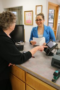 Member Paying Bill at Prosser Office