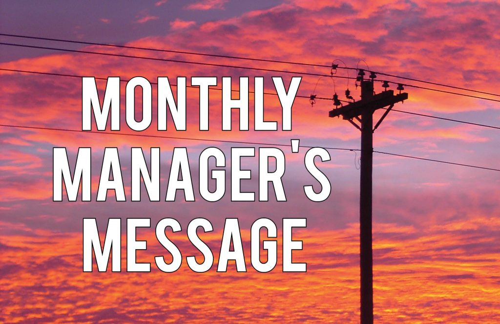 Monthly Manager's Message Header - Powerlines against a sunset