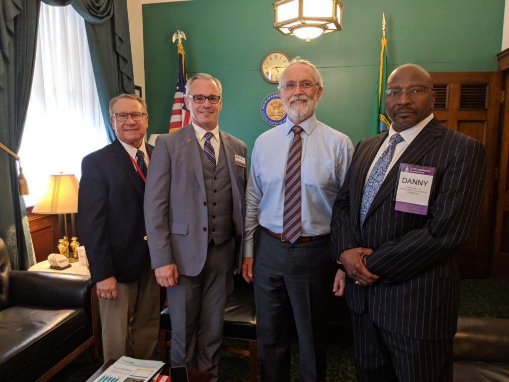 Randy Suess, Inland Power & Light; Troy Berglund, Benton REA; Rep. Dan Newhouse and Danny Lee, Inland Power & Light