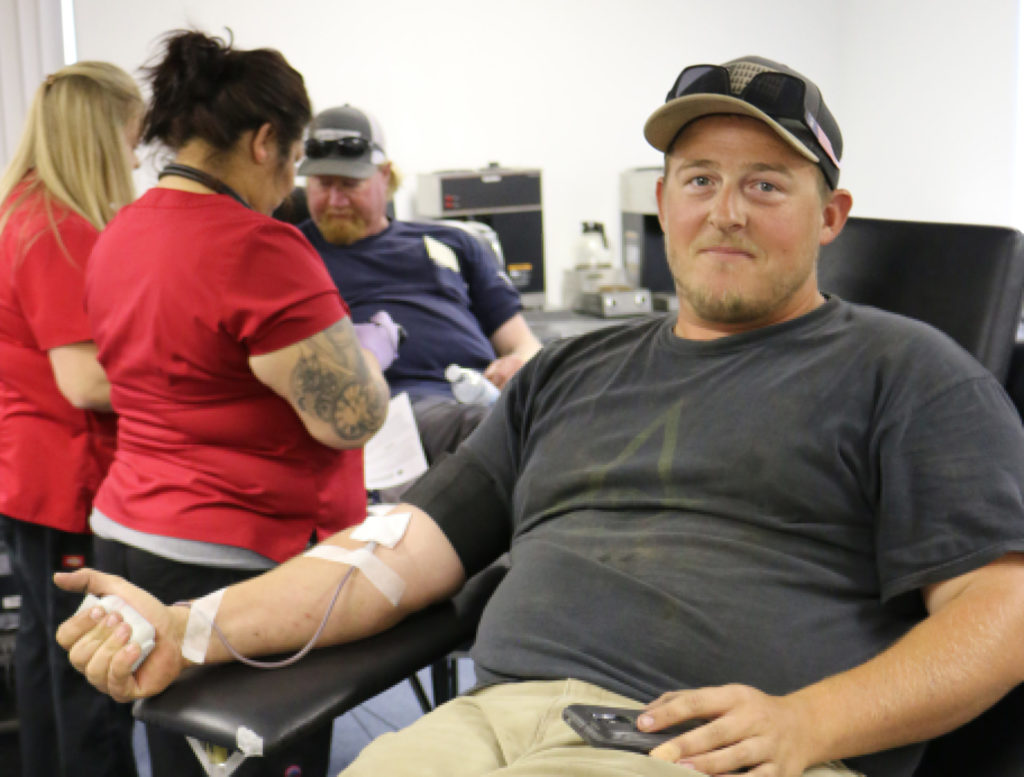 Benton REA Journeyman Lineworker Curtis Bohlke donated blood at the Co-op's drive on August 8, 2019.