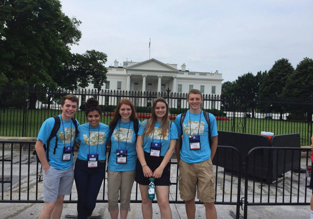Five students from Washington state pictured in front of the United States White House in Washington, D.C..